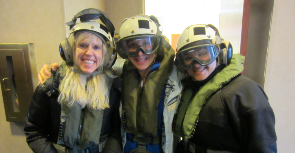 Bethany (middle) with other White House Fellows preparing to board a military flight to an aircraft carrier
