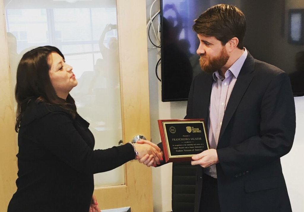 Francheska Salazar receiving an award from SVA President Jared Lyon